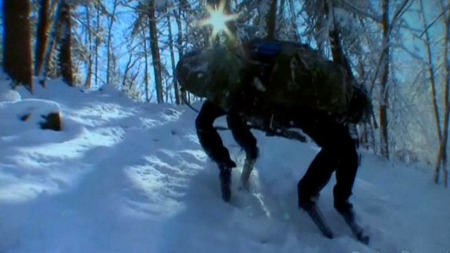 Robot pack mule known as 'AlphaDog' climbs snowy slope