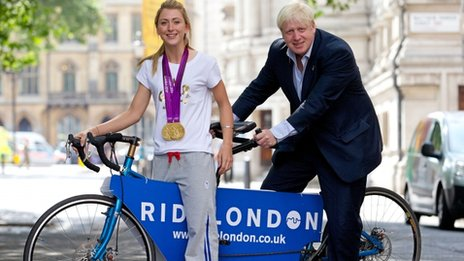 Great Britain cyclist and double gold medal winner Laura Trott (L) and London Mayor Boris Johnson pose for pictures