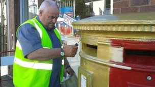 Post box painted gold in Flint