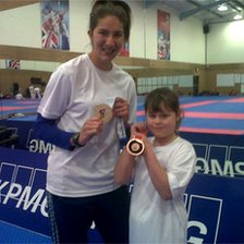 Sarah Stevenson and Alex Turner with Olympic medal 