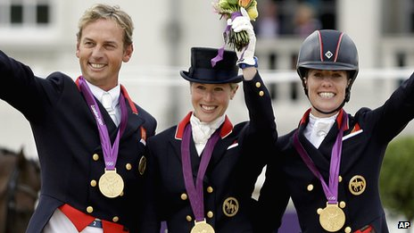 Carl Hester, Laura Bechtolsheimer and Charlotte Dujardin celebrating winning team gold at the London 2012 Olympics