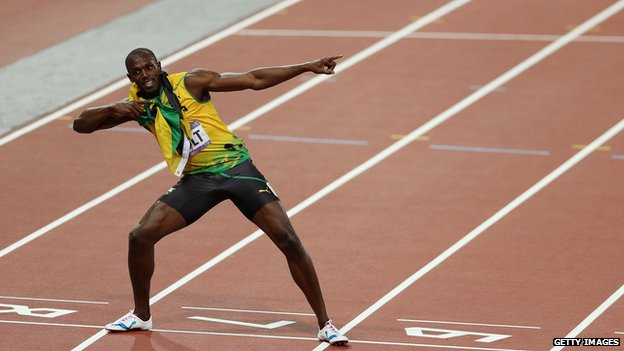 Usain Bolt posing on athletics track