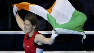Katie Taylor waves Irish tricolour