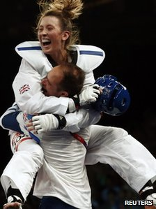 Jade Jones celebrates with her coach