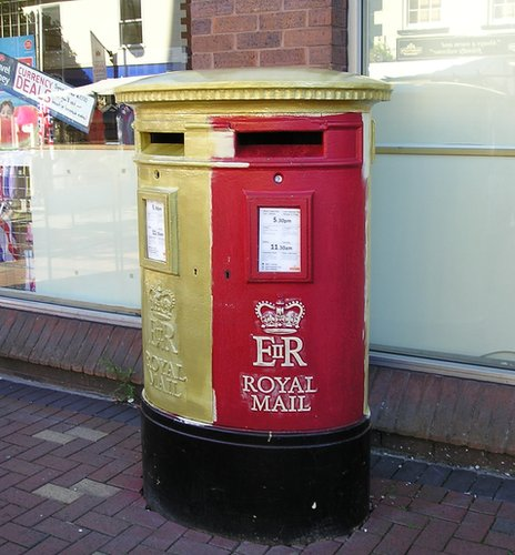 Half painted post box in Flint