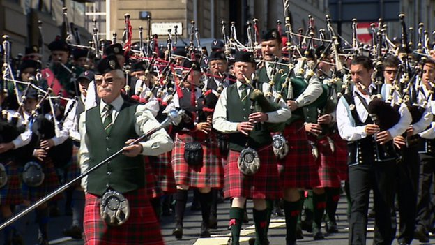 Pipers Beat the Retreat through Glasgow