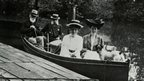 The Greg family in a steam boat on a lake