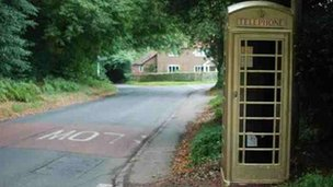 Golden phone box in Checkendon