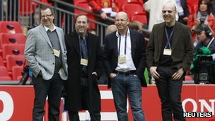 Manchester United board members Brian (L), Joel (2nd R) and Avram Glazer (R) watch their players during a training session at Wembley Stadium in London in this May 27, 2011