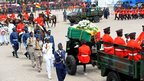 The coffin of Ghana's late President John Atta Mills is escorted to the Independence Square, in Accra - Friday 10 August 2012
