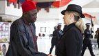 Alhaji Muhammad Mumuni greets Hillary Clinton