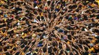Hindu devotees in Mumbai pray before forming a human pyramid