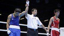Azerbaijan's Magomed Abdulhamidov is declared the winner over Japan's Satoshi Shimizu in boxing match