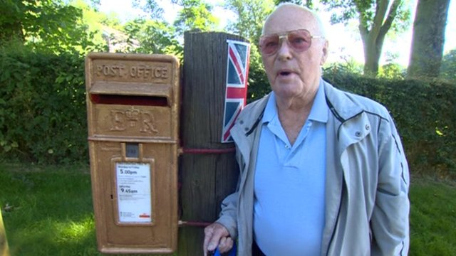 Peter Moran with the unofficial gold postbox