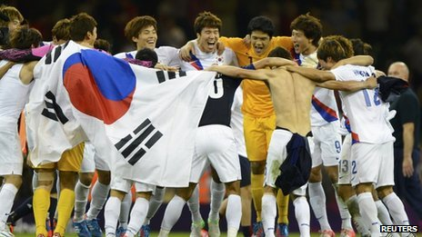 "South Korea's players celebrate their victory over Japan in the men""s bronze medal"