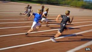 Children running on an athletics track