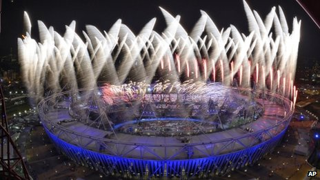 The outside of the main stadium during the fireworks at the end of the opening ceremony