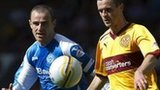 St Johnstone defender Dave MacKay keeps an eye on Motherwell's Jamie Murphy