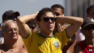 Brazil fans on Copacabana beach in Rio react as their team is defeated at the Olympics final