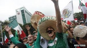 Mexican fans celebrate their football team's victory