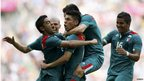 Oribe Peralta is embraced by his team mates after scoring a goal against Brazil in the Olympic final