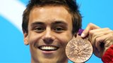 Tom Daley celebrates winning a bronze diving medal at London 2012