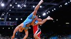 Takao Isokawa of Japan (in blight blue) in action against Magomed Musaev of Kyrgyzstan