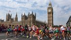 Athletes run past the Palace of Westminster during the men's marathon