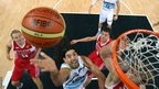 Luis Scala of Argentina puts a lay-up in the men's bronze medal basketball match against Russia