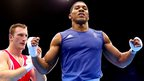 Anthony Joshua (in blue) celebrates beating Roberto Cammarelle in the super-heavyweight (81kg) final