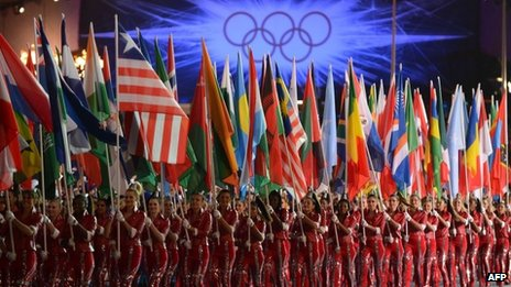 Artists hold flags at the Olympic stadium during the closing ceremony of the 2012 London Olympic Games in London, 12 Aug 2012