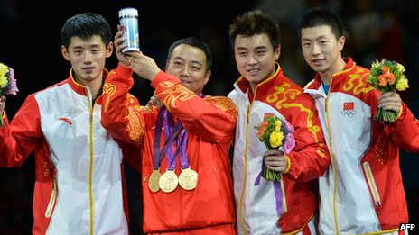 China's gold medallist team Zhang Jike, coach Liu Guoliang, Wang Hao and Ma Long pose after the podium of the table tennis men's team at the London Olympic Games, 08 Aug 2012