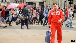 A man in a Russia Olympic tracksuit shops on Oxford Street
