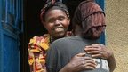 Bugesera village residents hugging
