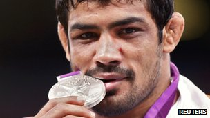 Indian wrestler Sushil Kumar with his silver medal