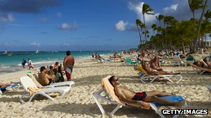 Tourists at Bavaro beach, in Punta Cana, Dominican Republic