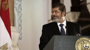 Egyptian President Mohammed Mursi looks on during a joint news conference with Tunisian President Moncef Marzouki