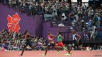 David Lekuta Rudisha of Kenya approaches the finish line ahead of Nijel Amos of Botswana to win gold and set a new world record in the Men&quot;s 800m Final.