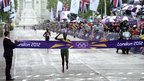 Gold medalist Tiki Gelana crosses the finish line ahead of silver medalist Priscah Jeptoo, from Kenya, and bronze medalist Tatyana Petrova Arkhipova, from Russia, in the women's marathon