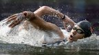 Tunisia's Oussama Mellouli swims during the men's 10-kilometer swimming marathon