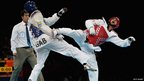 Anthony Obame of Gabon (L) fights Carlo Molfetta of Italy in the men's +80kg taekwondo gold medal match