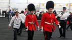 Olympic official from Yemen follows bearskin guards