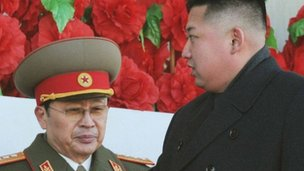 File image showing Kim Jong-un in foreground and Chang Song-taek in background on 12 February 2012