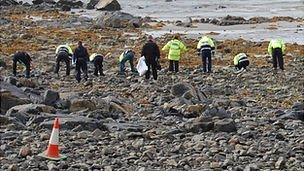 Guernsey Police officers and Civil Defence Volunteers search Belle Greve Bay