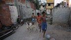 Boys play soccer in Vila Autodromo slum in Rio de Janeiro April 19, 2012.