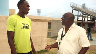 Usain Bolt with coach Glen Mills