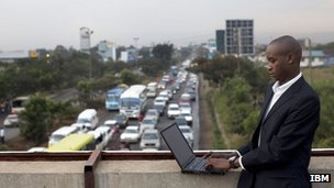 An IBM employee, gathering data on traffic congestion in Nairobi, Kenya