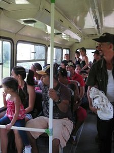 Visitors on a bus as they travel around the zoological park