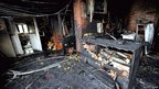 A primary school severely damaged by fire during the riots on Monday in Amiens