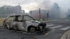 A burnt-out car in an Amiens neighbourhood
